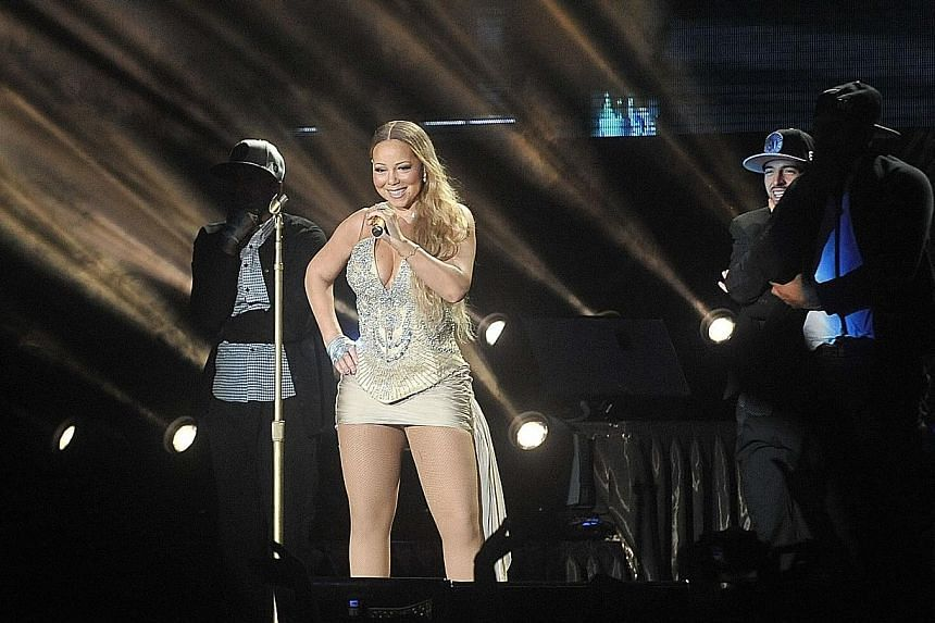 Unusual, which had brought singer Mariah Carey - seen here performing at the National Stadium on Oct 24, 2014 - and rock band Foo Fighters to Asia, will run Justin Bieber's concert in Singapore later this year. It wants to double the number of shows