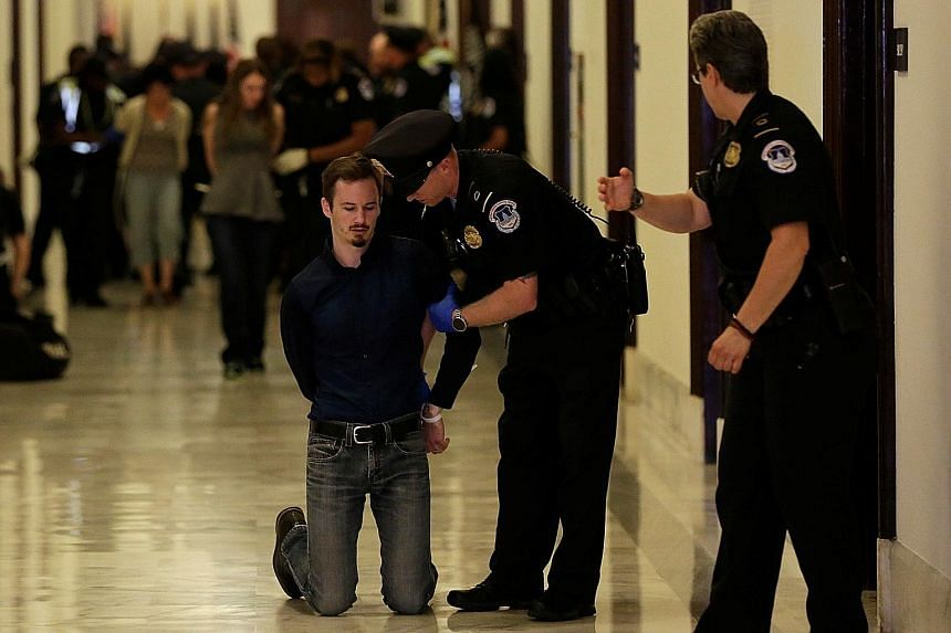Activists being detained on Monday after a protest against the Republican healthcare Bill at the Senate building in Washington. The week-long congressional recess only seemed to generate more doubts about the Bill.