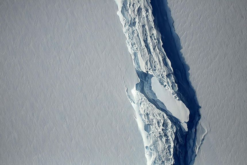 The ice rift in the Larsen C Ice Shelf in Antarctica last month (above) and the rift in November last year (left). A trillion-tonne iceberg snapped off the ice shelf sometime between Monday and yesterday.