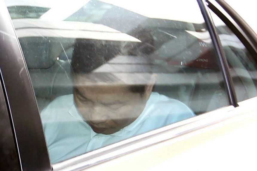 Chia Kee Chen in a car outside the Subordinate Courts on Jan 2, 2014.