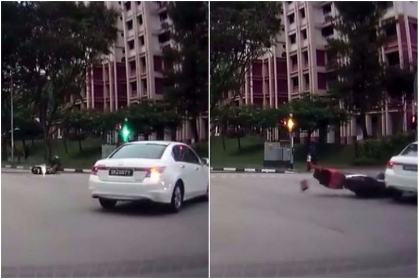 The motorcyclist suffered minor injuries after colliding with the car at a Woodlands junction.