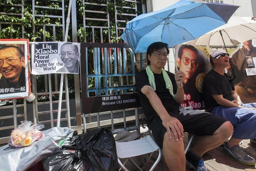 Supporters of Chinese Nobel laureate Liu Xiaobo participating in a vigil, in Hong Kong, on July 13, 2017.