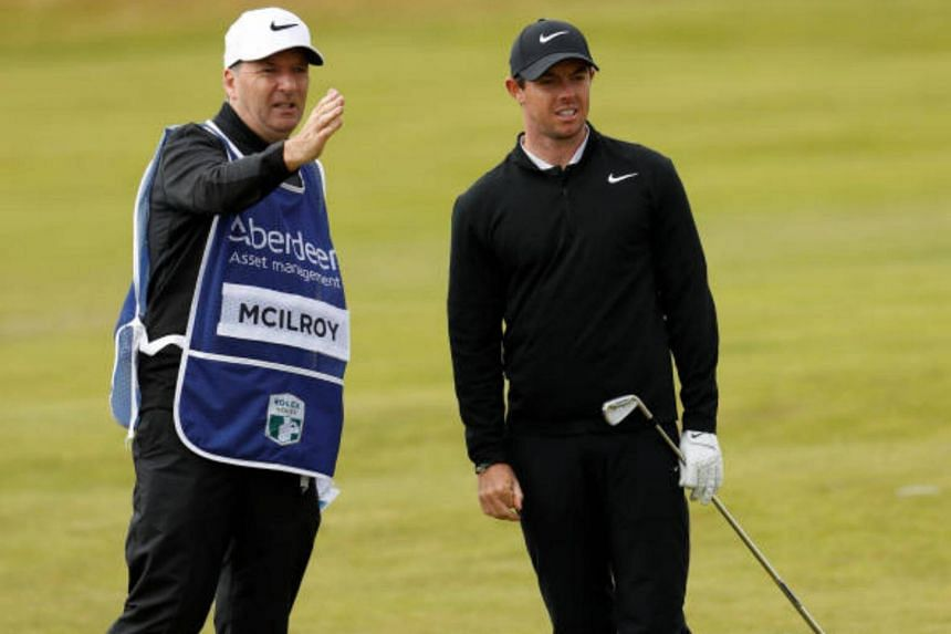 Northern Ireland's Rory McIlroy with his caddie during the first round on July 13, 2017.