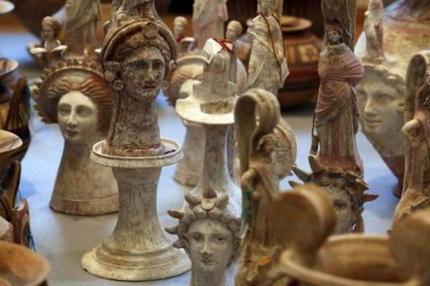 Caps Rare Greek and Roman amphoras, statues, vases and frescoes recovered by Italian and Swiss police from an art trafficking organisation.