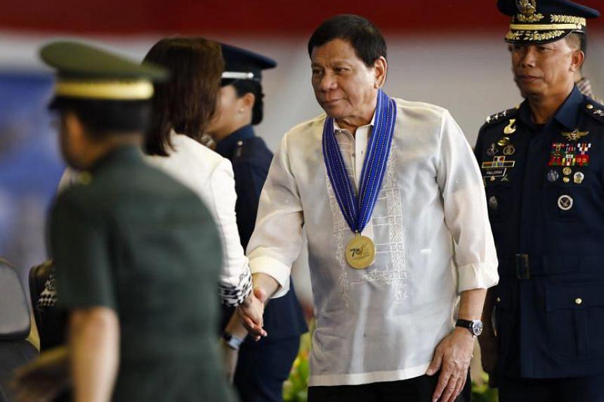 Philippine President Rodrigo Duterte greets Philippine Vice-President Leni Robredo at Clark Air Base on July 4, 2017.