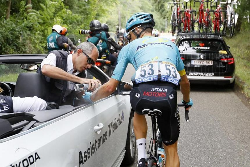 Astana Pro Team rider Jakob Fuglsang of Denmark receives medical assistance during the 11th stage of the 104th edition of the Tour de France cycling race over 203,5km between Eymet and Pau, France, 12 July 2017.