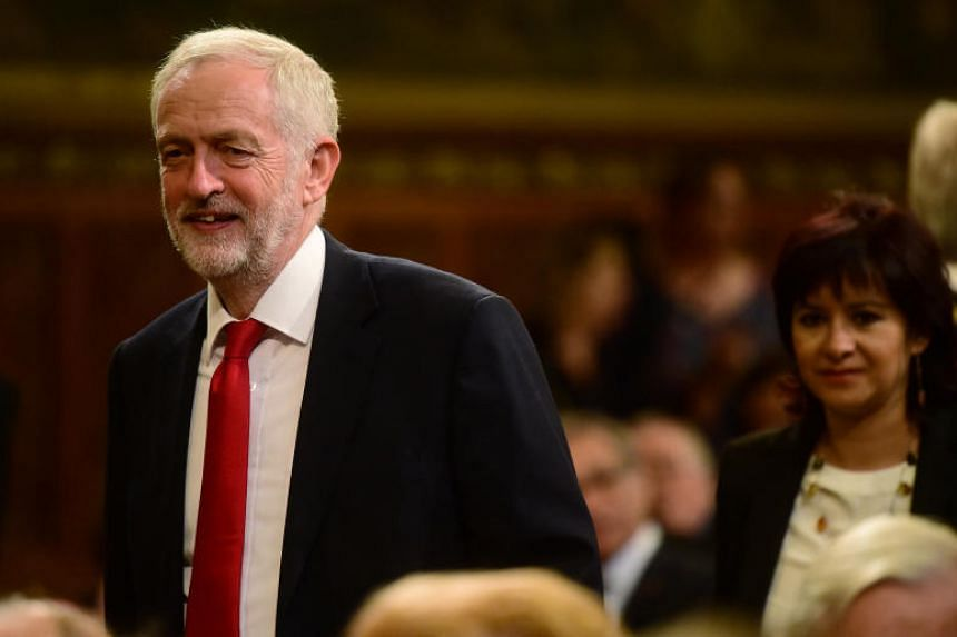 Jeremy Corbyn (left) and his wife Laura Alvarez are seen ahead of a speech by Spanish King Felipe VI at the Palace of Westminster in London.