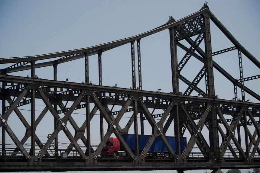 A truck is seen crossing the Friendship Bridge from North Korea's Sinuiju over to the Chinese border city of Dandong.