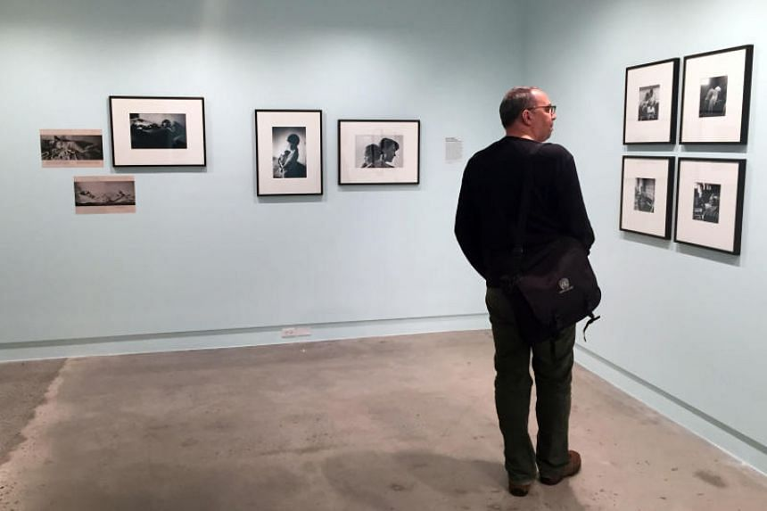 A man looking at photos in an exhibition of the 70th anniversary of photo agency Magnum, which runs until Sept 3 at the International Center of Photography in New York.