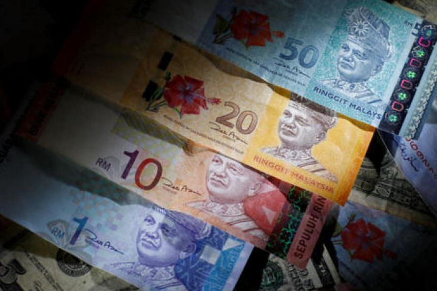 Malaysian ringgit notes are seen among other currency notes in this photo illustration taken in Singapore on March 14.