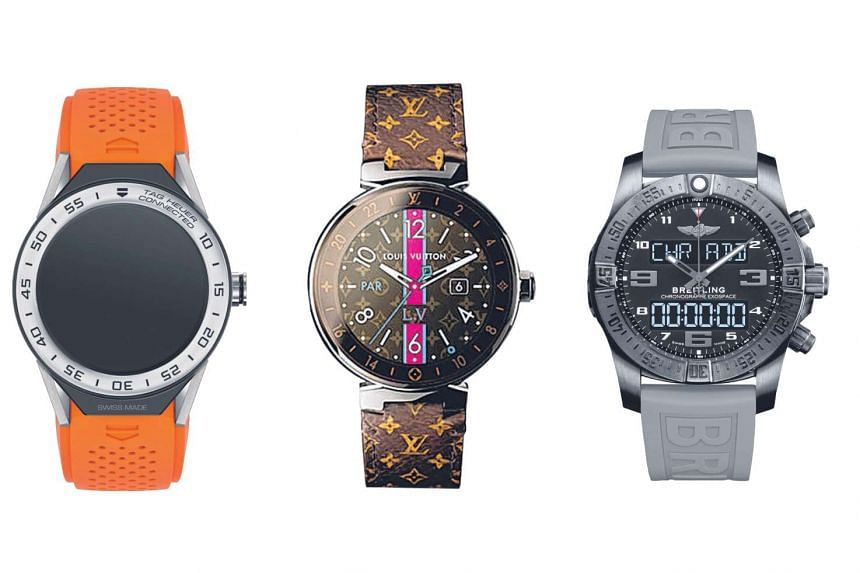 Luxury brands that have jumped on the smartwatch bandwagon include (from left) Tag Heuer with the Connected Modular 45, Louis Vuitton with the Tambour Horizon and Breitling with the Exospace B55.