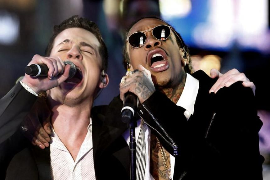 The music video for See You Again, by singers Charlie Puth (left) and Wiz Khalifa, has notched 2.9 billion views as of early Tuesday