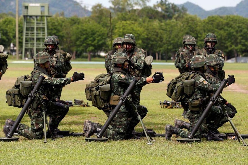 Soldiers attend a demonstration of combat readiness at the 31st Infantry Regiment, King's Guard in Lopburi province, Thailand.