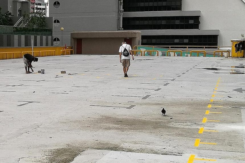Golden Mile Tower carpark owner LHN Group had previously lodged a police report over what it described as an act of vandalism after vendor lots were demarcated across the rooftop carpark space.