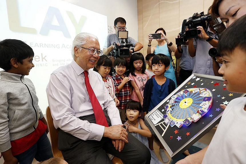 President Tony Tan visiting Play@TP, the polytechnic's experimental kindergarten, where poly students taking an early childhood studies course get a chance to teach pre-schoolers under the guidance of a mentor-teacher, while the kids are encouraged t