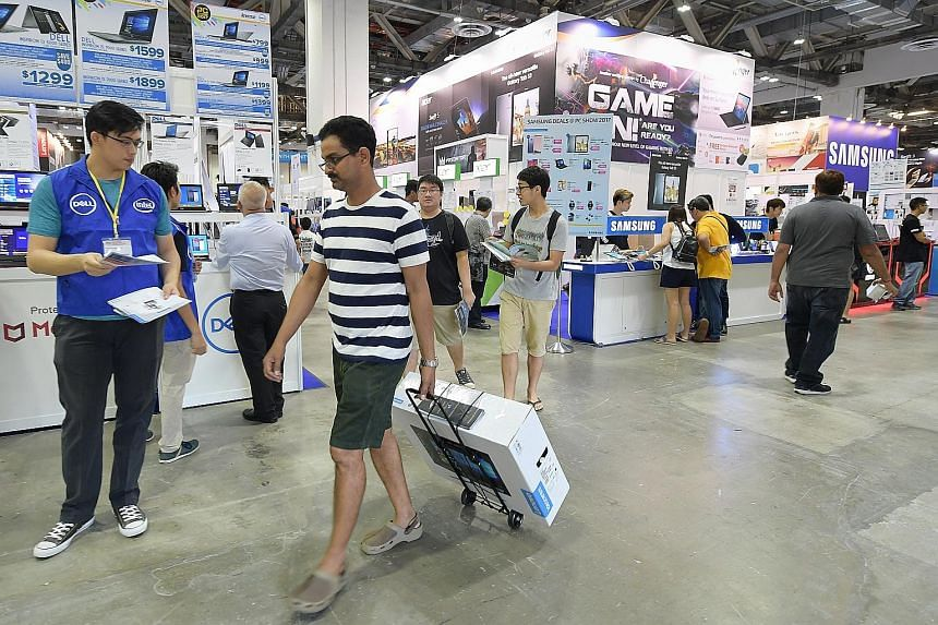Shoppers checking out The PC Show at the Marina Bay Sands Expo and Convention Centre last month. PC shipments worldwide are down for the 11th quarter in a row, according to Gartner data.