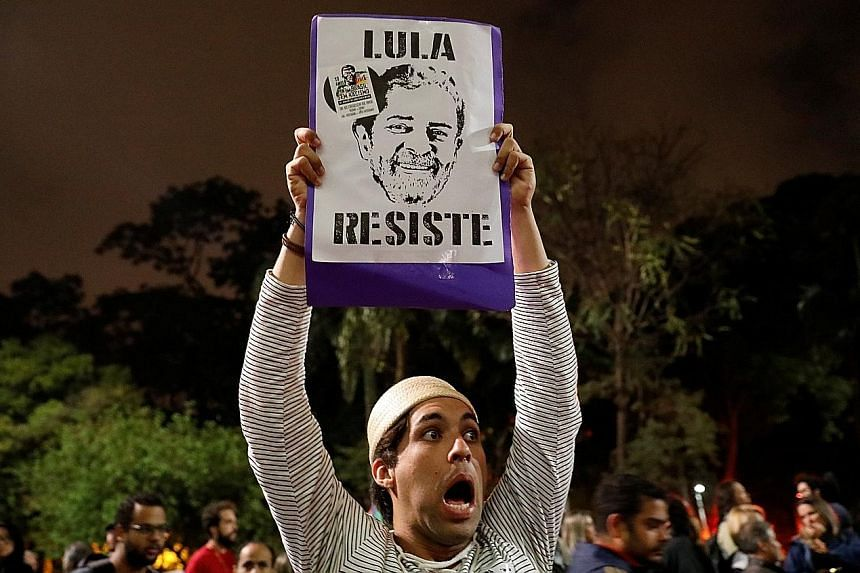 A supporter of former Brazilian president Luiz Inacio Lula da Silva protesting after the latter's conviction on corruption charges in Sao Paulo, Brazil, on Wednesday. Political experts said the graft conviction opens the door for an outsider to take