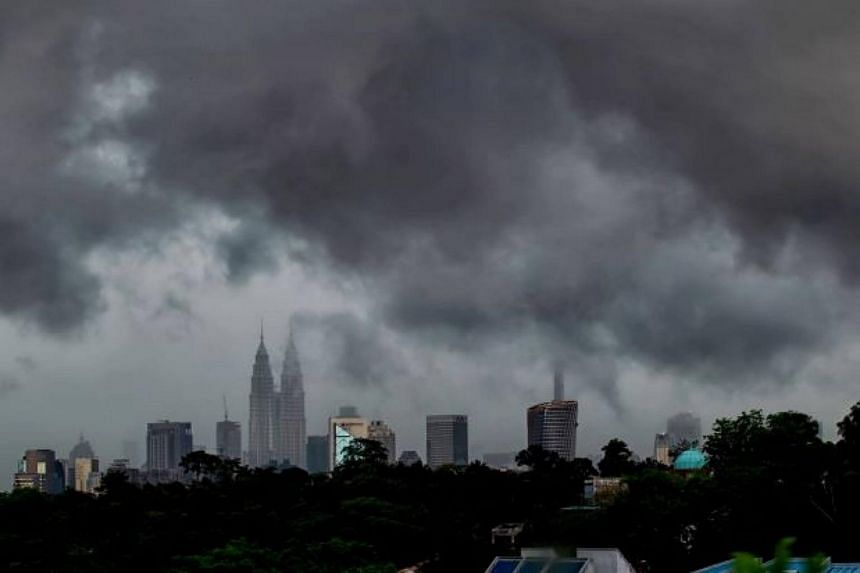 Heavy rain and strong winds uprooted trees and blew off roofs in several parts of Malaysia's capital on Thursday.