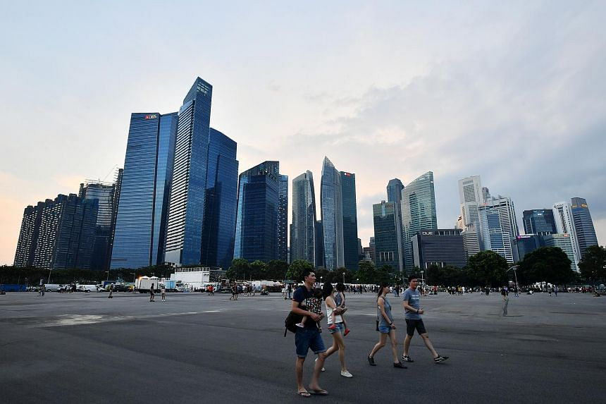 People walking at the Marina Bay Financial Centre, in the Central Business District of Singapore.