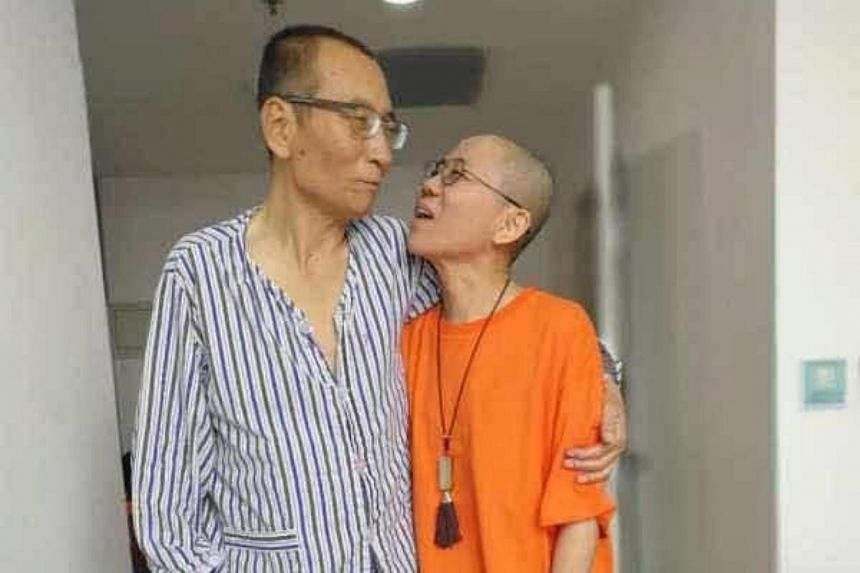 Chinese dissident Liu Xiaobo (left) with his wife Liu Xia, at an undisclosed location.