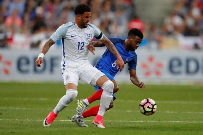 England's Kyle Walker in action with France's Thomas Lemar for a friendly match on June 13, 2017.