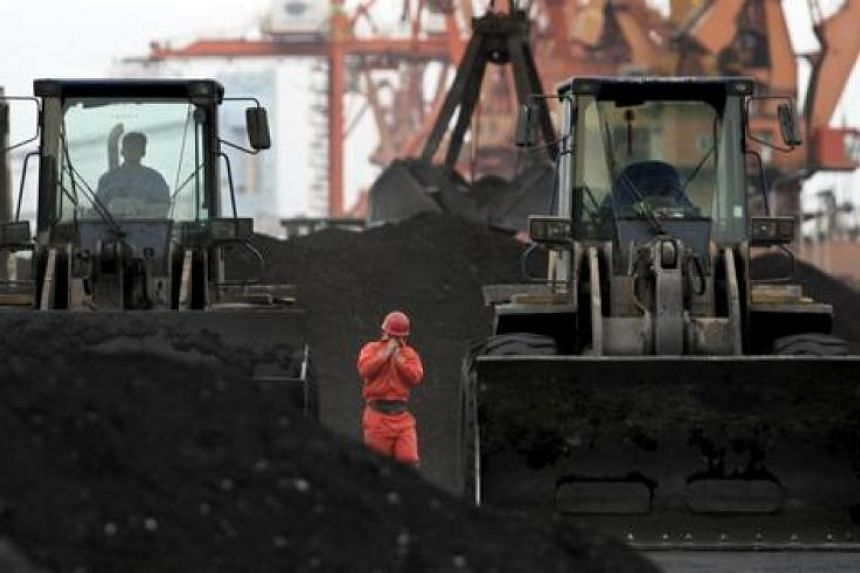 Coal imported from North Korea at Dandong port in the Chinese border city in Liaoning province in December 2010. For the Chinese government, purchases of iron ore provide a way to support the regime of Mr Kim Jong Un now that sanctions more strictly