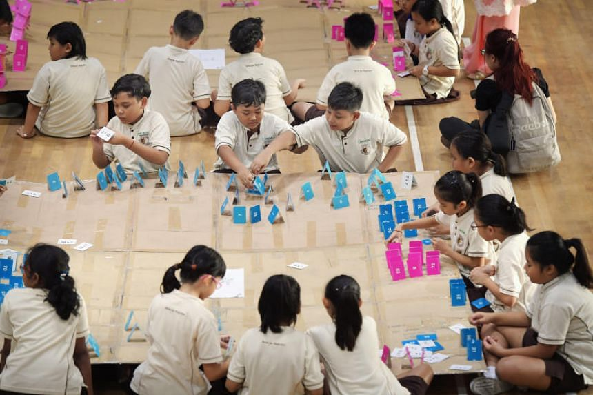 Primary Four pupils of Boon Lay Garden Primary School build card houses as part of an exercise to launch the start of the school's two-week Racial Harmony Day (RHD) celebrations andactivities on July 10, 2017.