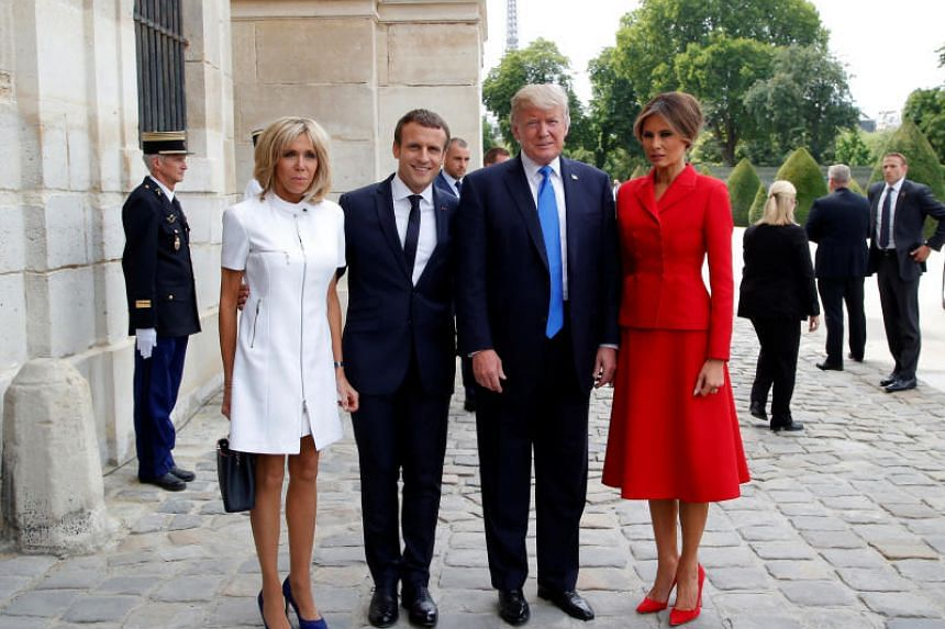 French President Emmanuel Macron (second from left) poses next to his wife Brigitte Macron (left), US President Donald Trump and Us First Lady Melania Trump outside the Army Museum during a ceremony at Les Invalides in Paris, on July 13, 2017.