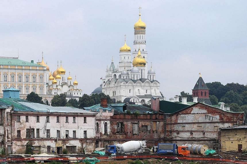 The construction site of a new city block on Moscow's Sofiyskaya embankment, with the Kremlin's towers and cathedrals seen in the background on July 14 2017.