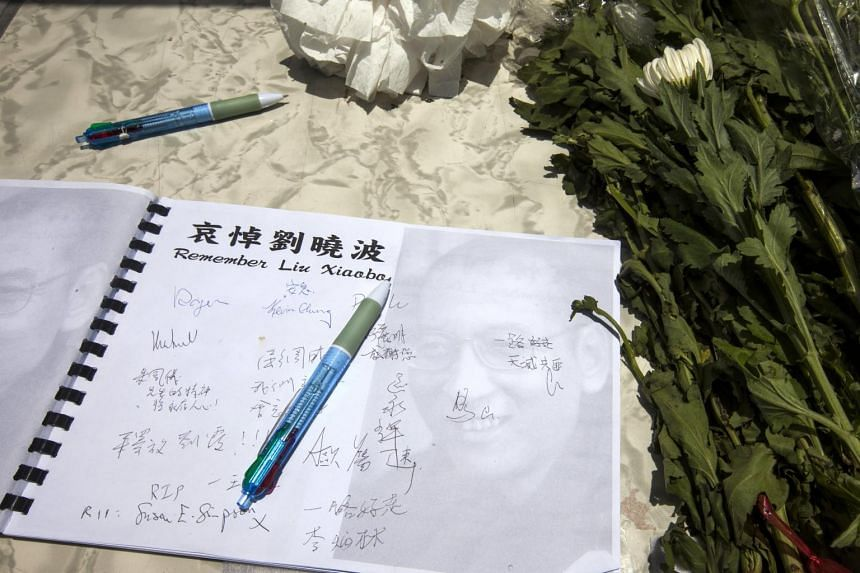 A book of condolences for the late Chinese dissident and Nobel peace laureate Liu Xiaobo lies open at a makeshift shrine outside the China Liaison Office in Western District, Hong Kong, China, July 14, 2017.