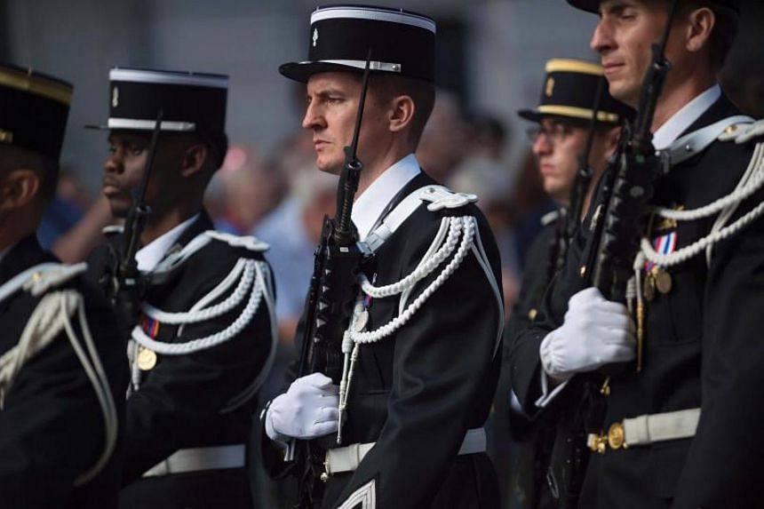 French troops take part in a military parade on July 13, 2017 in Lyon, central eastern France, on the eve of the celebrations of the Bastille Day.
