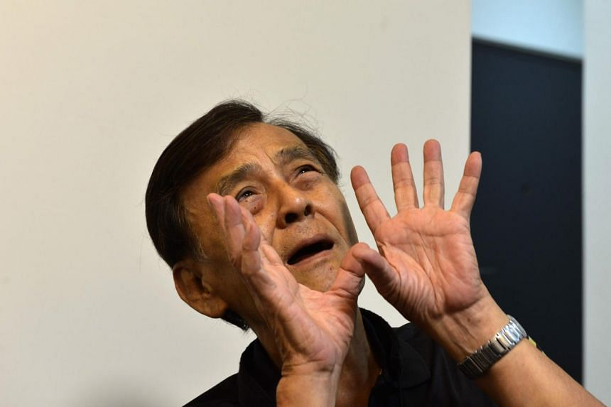 Taiwan musician and former political prisoner Chen Shen-ching gestures during an interview in New Taipei City.