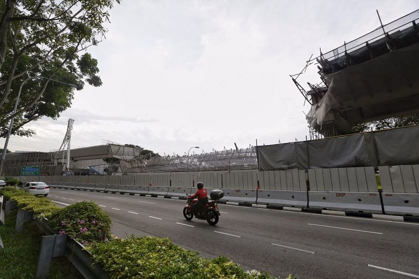 The collapsed section of a highway under construction as seen along the slip road from PIE to TPE.