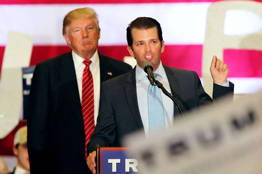 US Republican Presidential candidate Donald J. Trump listens to his his son Donald Trump Jr. speaking to supporters during a rally at Lakefront Airport in New Orleans, Louisiana, USA, on March 4, 2016.