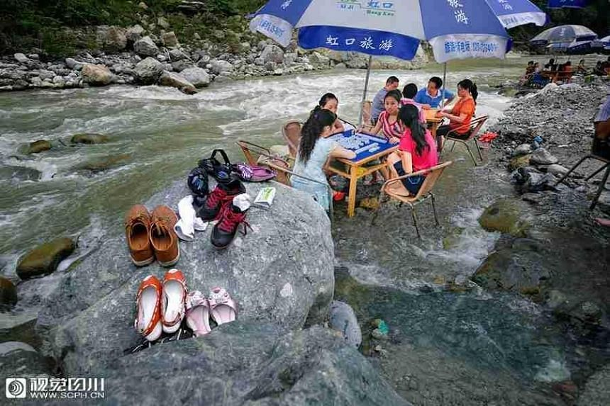 As many as 21 provinces and regions in China are baking from a heatwave that has seen ground temperatures of up to 50 deg C.