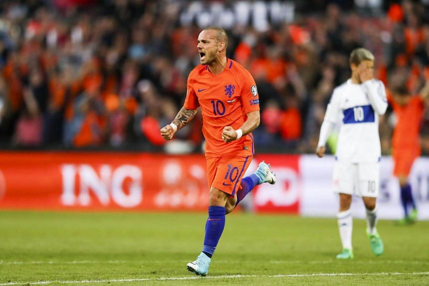 Wesley Sneijder of the Dutch national team celebrates 2-0 against Luxembourg during the semifinals of the PSA Dubai World Series Finals 2017 at Dubai Opera in Dubai, United Arab Emirates, on June 9, 2017.