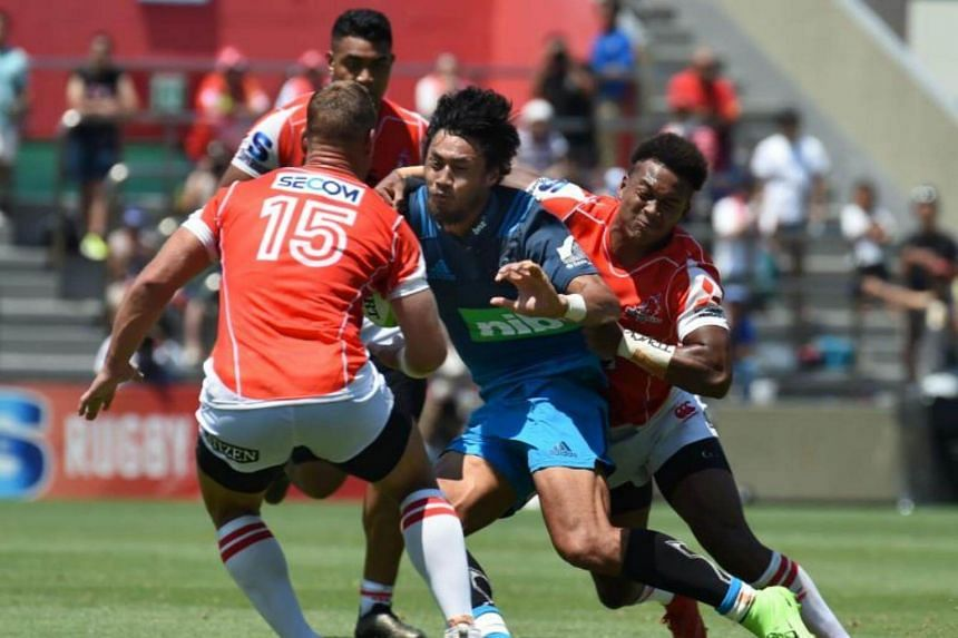 Melani Nanai (C-blue jersey) of the Blues is tackled by Sunwolves players during the Super Rugby match between the Sunwolves of Japan and the Blues of New Zealand at Prince Chichibu Memorial Stadium in Tokyo on July 15, 2017.