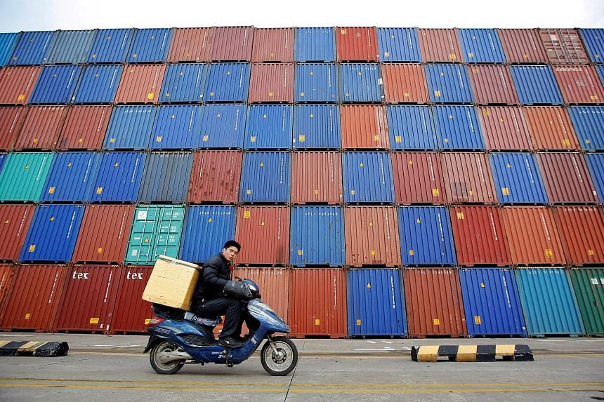 Shipping containers in Shanghai. In Asia, the outlook remains dovish. For instance, the Bank of Japan is not expected to significantly change its massive bond buying programme anytime soon, and China's authorities remain in supportive mode, even as t