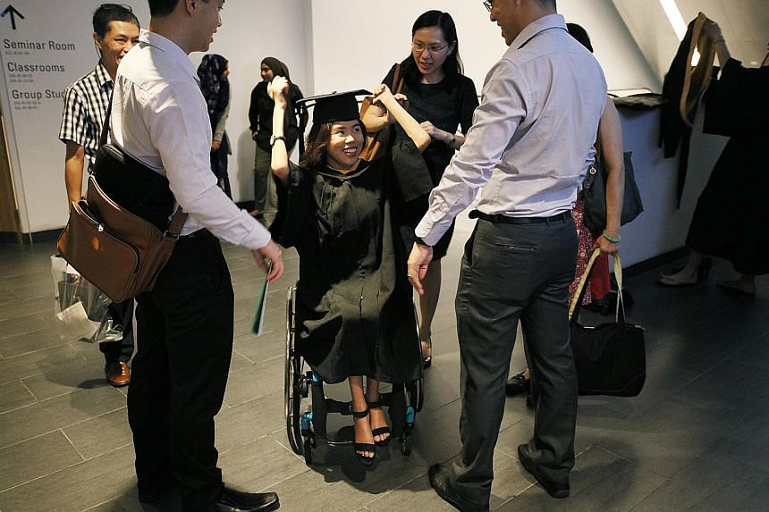 Yip Pin Xiu adjusting her mortar board before her commencement ceremony at SMU, having deferred her studies for a year to focus on training for the Rio Games. The three-time Paralympic champion will next compete in the Asean Para Games and World Cham