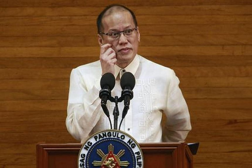 "Former Philippine president Benigno Aquino, seen in a 2015 photo, has been indicted for graft and ""usurpation of authority"" in connection with a raid on the lair of Malaysian terrorist Zulkifli Hir in 2015."
