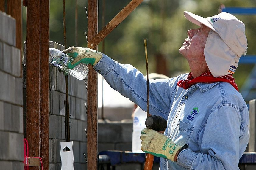 Mr Jimmy Carter taking part in Habitat for Humanity building efforts in Chiang Mai, Thailand, in 2009. He was in Canada doing work for the organisation when he collapsed on Thursday.