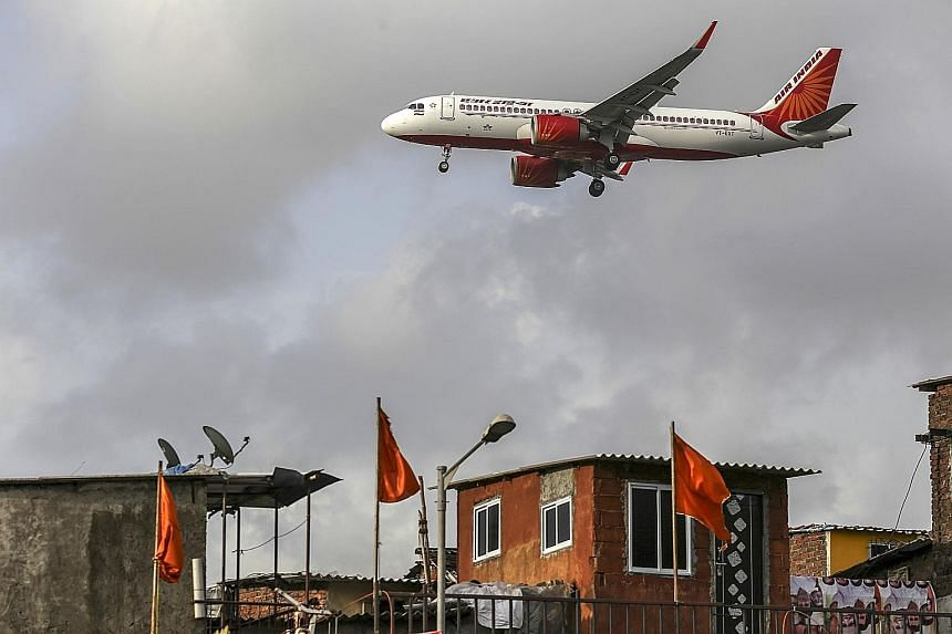 An Air India aircraft landing at Chhatrapati Shivaji International Airport in Mumbai. The Indian Cabinet last month approved the sale of Air India, which has an US$8 billion (S$11 billion debt).