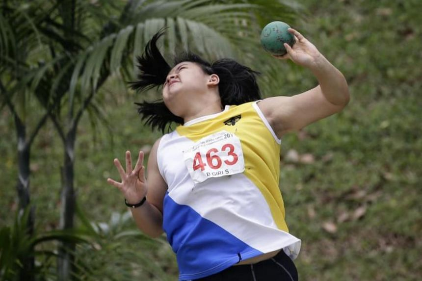 Nanyang Girls' High's (NYGH) Jasmin Phua winning the B Division girls' shot put finals with a record throw of 12.73m during the National Track and Field Championships at Hwa Chong Institution on April 10, 2017.