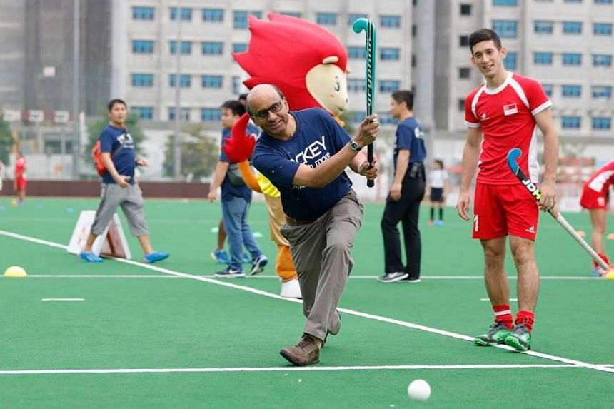 Deputy Prime Minister Tharman Shanmugaratnam scores from his effort at the ActiveSG Hockey Academy Launch.