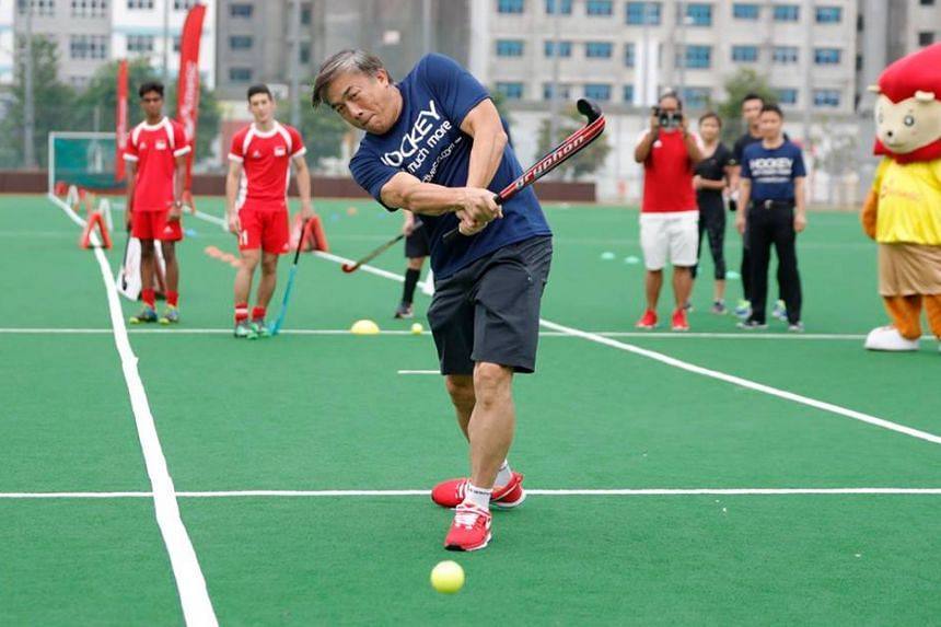 SportSG CEO Mr Lim Teck Yin scores as part of the official launch of the ActiveSG Hockey Academy.