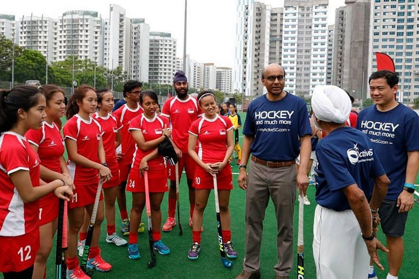 Team Singapore hockey players with DPM Tharman at the launch of the ActiveSG Hockey Academy.