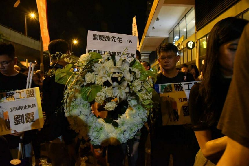 People take part in a silent protest march in honour of the late Nobel Peace laureate Liu Xiaobo in Hong Kong.