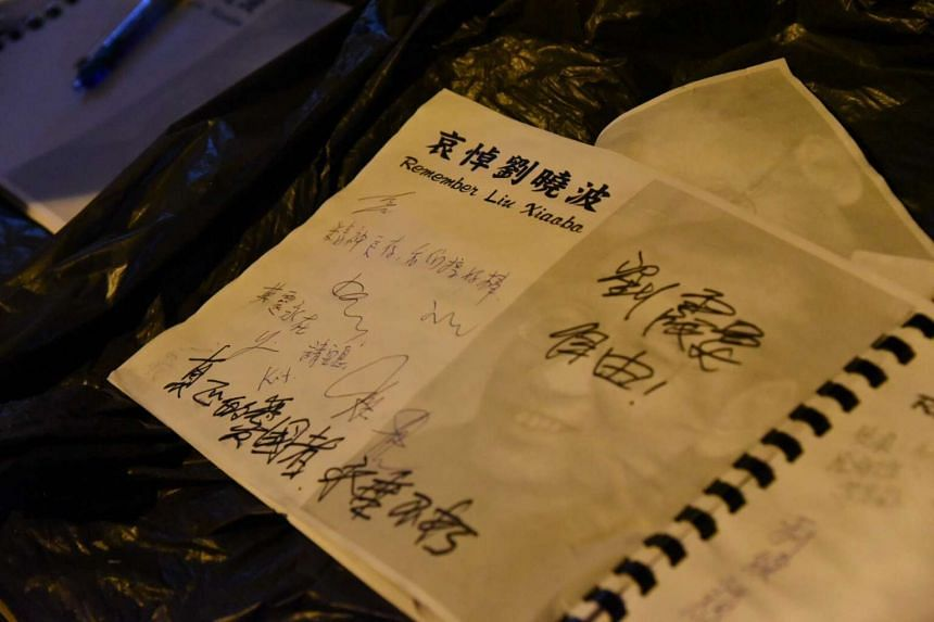 A book of condolences for the late Nobel Peace laureate Liu Xiaobo was signed during a silent protest march in Hong Kong.