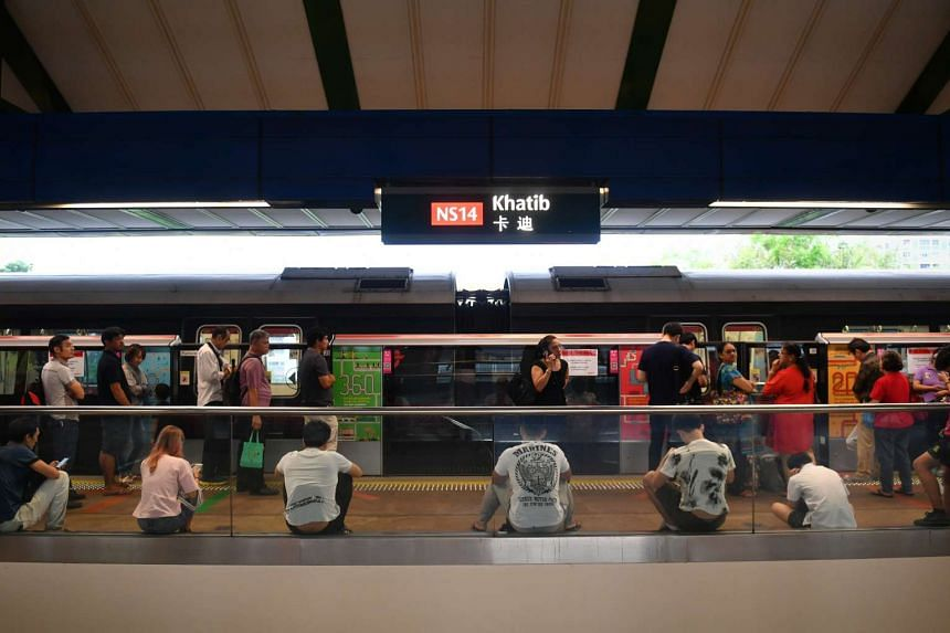 Commuters waiting at Khatib MRT station because of train delays due to signalling faults, on June 28, 2017.