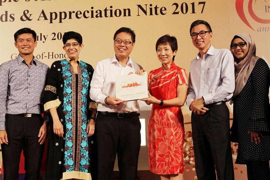 From left: People's Association (PA) chief executive director Desmond Tan, PA Integration Council adviser Fatimah Lateef, PA Integration Council chairman Goh Peng Hong, Ms Grace Fu, PA Integration Council adviser David Tay and Madam Rokiah Bee Mohame